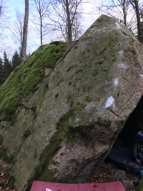 Goes up the slab, just left of the arete.